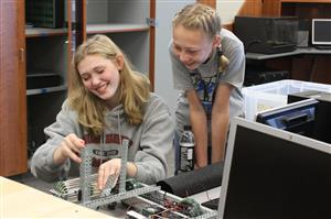 Two students working on a robotics project.
