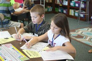 two students working on writing